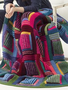 Free Knitting Pattern for Mountain Cabin Afghan - 25 Blocks are worked separately, then sewn together. Each Block begins with a Center, then 8 Logs are worked around theCenter. Great use for stash or scrap yarn. Designed by Irina Poludnenkofor Lion Brand Yarn