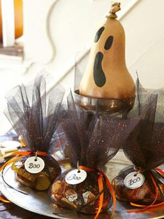 Give dearly departing guests a sneaky send-off with tulle-shrouded favors that conceal foil-wrapped candies and more. #halloween