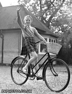 Young Julie Andrews on bicycle