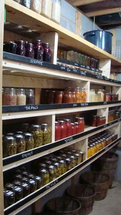 "Pantry idea: The 1""x2""s that help keep the canning jars from falling are painted with chalkboard paint. Then you can label each section with what is stored in the jars."
