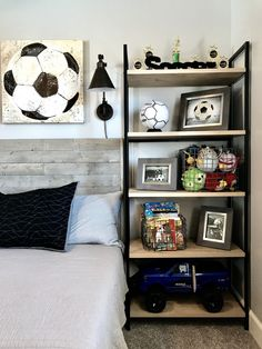 Industrial style boy soccer themed bedroom. DIY handmade wood bed. Shelves, photos frames and wire baskets are from Target. #soccerBoysandGirls