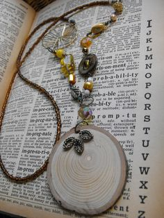 Chelsey Collage Necklace!The Sun Catcher Collage Necklace / Wooden Pendant / by chelslj3, $38.00