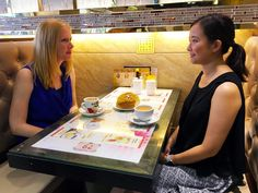 Who's trying the pineapple bun first? With Silvana Leung of Hong Kong Foodie in a local's diner in Sham Shui Po, a foodies area of Hong Kong.