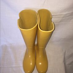 Sperry Top Sider Pelican Tall rain boot! Pair of awesome bright yellow rain boots! Worn only a few times. Adjustable strap at calf. Some slight imperfections but nothing noticeable. Sperry Top-Sider Shoes Winter & Rain Boots