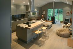 Really like the kitchen island and that wood bar on the kitchen island - Sarah JaneNielsen my-dream-home-inspiration