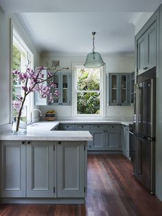 Spring kitchen with robins egg blue cabinets