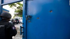 A manhunt is underway after 174 inmates escaped from a prison in Haiti following a riot during which one guard was killed, authorities said.
