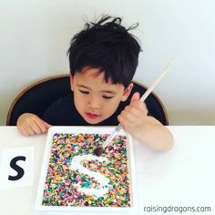 Letter Writing in Sprinkles Tray ages Sensory writing trays are such a fun way to learn letters number and shapes and this letter writing in sprinkles tray is our favorite writing tray! Letter Writing in Sprinkles Tray ages 3 Toddler Fun, Toddler Learning, Toddler Crafts, Crafts For Kids, Infant Activities, Preschool Activities, Homeschool Kindergarten, Online Homeschooling, Activities For 3 Year Olds