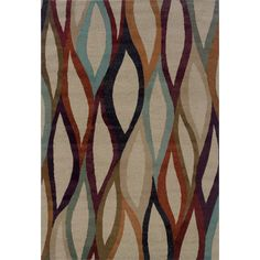 A bold abstract design bursting with color in shades of plum, spa blue and orange sets this contemporary rug apart. High-twist two-tone yarns add interesting texture to this area rug.
