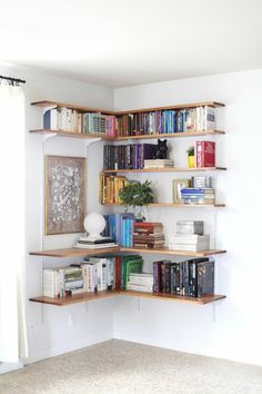 DIY Wall-Mounted Shelving Systems Easy to Install One of my favorite small space hacks is swapping your bookcases for wall-mounted shelving. We've created roundups of wall mounted shelving systems before, but for those of you who are especially crafty t Design Ikea, Diy Design, Design Trends, Wall Mounted Shelves, Wood Shelf, Diy Wall Shelves, Shelves For Walls, Ikea Shelves, Pallet Shelves