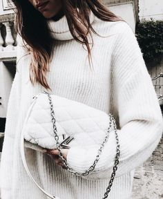 Oversized white knit sweater with cute white handbag.