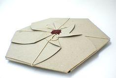 origami 12 inch vinyl sleeve using laser cut text, blue vinyl and a custom wax seal.