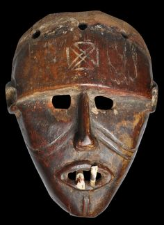 Chokwe People, Angola/Congo  early 1900s  This fine mask is from the Chokwe (or Tchokwe) people of Angola and the 'Democratic' Republic of the Congo. It is of carved wood with applied teeth