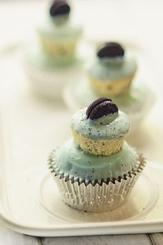 Mint Oreo cupcake with mini cupcake topper.