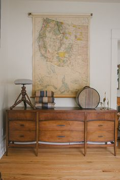 Antique wall maps make a stunning statement in any home.  They can be pricey so also consider large reproductions that are equally gorgeous but easier on your wallet.  Check out the antique and reproduction maps at www.mapsofantiquity.com  We can also make custom reproductions!