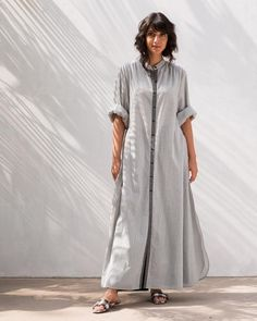 dca9b13b685d2 A Good Opening Check Kurta - Black from Women collection at Nicobar. Nicobar  is for modern consumers who seek connection with things they acquire.
