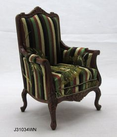 Sillón escala 1/12 en nogal, tallado y tapizado en  tela de seda a rayas y con mariposas bordadas