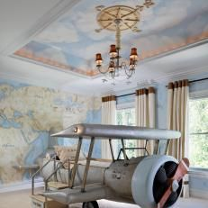 Dreamy Kid's Travel-Themed Bedroom With Airplane-Shaped Bed