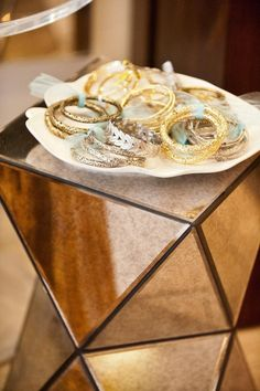 A dish of goodies: http://www.stylemepretty.com/living/2015/03/09/20-creative-ways-to-organize-your-jewelry/