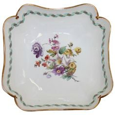 "Meissen porcelain centerpiece bowl with floral decoration and gilt edging, square form with notched corners, Late 19th C, 10""w, 4""h. Minor wear to painted decoration and rubbing to gilt edge."