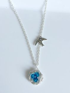 Bird Nest Necklace with Three Blue Eggs and Sparrow Charm