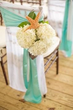 Starfish hydrangea aisle markers / http://www.himisspuff.com/starfish-beach-wedding-ideas/8/