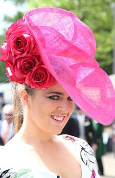 The glamorous to the bizarre. Enormous plumes of feathers, oversized blooms and elegant silk roses all proved popular with guests.  Towering plumes of feathers, sculpted fascinators, supersized blooms and rainbow brights were all seen on the heads of racegoers - totally eclipsing the demure shift dresses beneath.