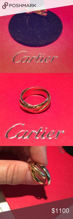 Cartier Tri gold rolling ring Cartier rolling ring white, yellow and rose gold. It's either a size 52 or 54, need stronger readers to see it. Guaranteed authentic, no box or papers. Was a gift long time ago and now it doesn't fit so that's why I'm selling. Please no low balling, price is firm and no trading! Cartier Jewelry Rings