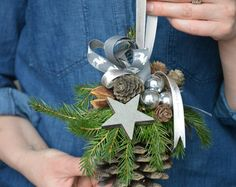 Christmas is a special time... Let the decorations create a magical Christmas spirit in your house...  Large Pine Cone Christmas Ornament Hanging door / wall décor.  Materials used: pine cone, grey ribbons, fresh BLUE spruce, mini pine cones, small silver glass baubles, wooden star painted in grey.  Measurements: height of cone 14 cm an diameter approx. 9 cm, height of cone with hanger 24 cm, weight: 0,200 kg approx.  This arrangement can work as an amazing décor for your home or a unique…