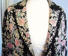 I love this jacket, I know that it might upset some people that a shawl was cut up to make this but it is so beautiful.