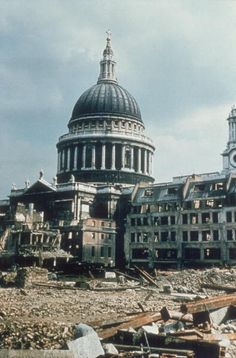circa 1940: The famous dome of St Paul's Cathedral in London surrounded by debris from a World War II German bombing raid. (Photo by Topical Press Agency/Getty Images)