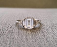 Etsy Antique White Sapphire Diamond Engagement Ring Emerald Cut Baguette Classic White Gold timeless Pene