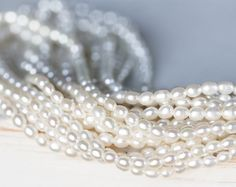 2396_Small shiny pearls 3-3.5x3 mm, Oval pearls, Rice pearls, Natural white pearls, Ivory freshwater pearls, Pearl beads, Cultivated pearls. by PurrrMurrr on Etsy