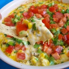 Hot Corn Dip Recipe Appetizers with shredded cheddar cheese, jack, chipotles in adobo, diced green chilies, mayonnaise, garlic powder, corn, small tomatoes, cilantro, green onions