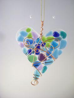 Fused glass heart suncatcher in blues, greens & purples.