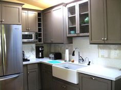 Grey tone painted cabinets and an apron front sink.