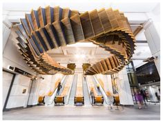 """Interloop"" by Chris Fox - an 80 year old wooden escalator repurposed as a sculptural ribbon in Wynyard Station, Sydney, Australia, 2017."