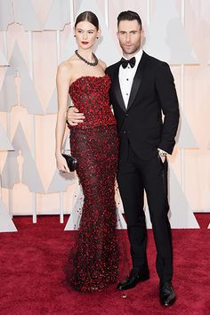 Adam Levine (r.) and Behati Prinsloo proved they are the perfect match by both donning Armani Prive red carpet ensembles at the 2015 Oscars on Feb. Behati Prinsloo, Armani Prive, Adam Levine, Cute Celebrity Couples, Cute Couples, Sienna Miller, Chloe Grace Moretz, Diane Kruger, Charlize Theron