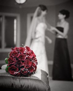 The Brides bouquet lies in the foreground as she gets ready for her wedding