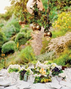 """With help from Bryan """"Breezy"""" Ream,this couple lit up their reception area with a hanging Italian crackle-glass globe surrounded by four vintage brass domes."""