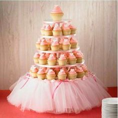 Good Way to dress up a cupcake stand….girl baby shower Or princess/ballerina birthday party… this could be cute even without cupcakes. …could even serve veggies or anything else on the platters. Maybe one on a stand like this, one for the punch bowl, etc Ballerina Birthday, Princess Birthday, Princess Party, Girl Birthday, 1st Birthday Parties, Ballerina Tutu, Birthday Ideas, Princess Cupcakes, Birthday Cakes