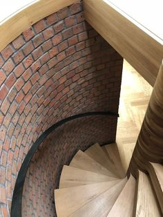 Bespoke 'floating' Spiral staircase with steel treads clad in solid oak. A steel handrail finishes off the look. Made to fit perfectly into this curved, brick space. Steel Handrail, High End Kitchens, Bespoke Kitchens, Spiral Staircase, East Sussex, Joinery, Stairways, Carpentry, Solid Oak