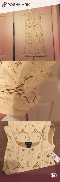 Mini Sexy Cream/Tan Dress. NWT! I bought this from another posher and it was too small unfortunately. It is a size XS/small from Wet Seal. I would say it fits more as an XXS/XS though. It has a tan liner underneath so that you don't have to worry about see through sections. VERY STRETCHY and cute. I only paid $8 on Posh so I am just trying to break even! Wet Seal Dresses Mini