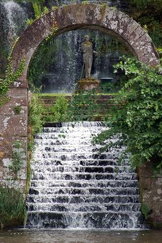 The flooded stair and gate motif adds an air of mystery. Don't you want to see what else is at the top of this fountain?