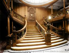 """Stunning colorized photo of the forward 1st class staircase on Olympic. Notice how dark it is on A Deck next to the staircase. That area is where you would head down to the deck below, or behind the staircase to the elevators. The Olympic class was not the bright ship featured in movies, such as """"Titanic"""", rather very dark small spaces. Even at night, with all the lights on, the capacity of the bulbs would have made it very """"cozy"""" inside the passenger areas..."""