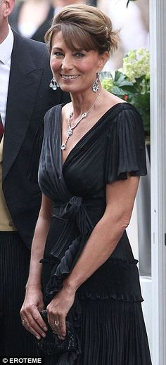 Carole Middleton going to the reception at Buckingham Palace the night of the wedding. Lovely detail work and fabric of the dress, but black is an odd choice for your daughter's wedding reception.