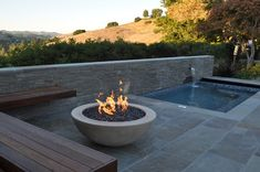 LOVE the fire bowl and the wall facade...and the floor but it's real tile not stamped concrete...