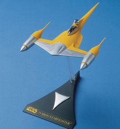 """AMT/Ertl Star Wars Naboo fighter model - One of the stars of """"Star Wars: Episode I,"""" the sleek, brightly-colored Naboo Starfighter is quite a departure from the drab, """"guts on the outside"""" spacecraft of the original """"Star Wars"""" trilogy."""