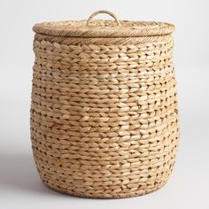 Keep laundry or other clutter hidden neatly under the lid of our elegant basket, woven from natural seagrass with a slight sheen for a polished look. A loop handle on the lid and cutout handles on each side make it easy to open and tote.