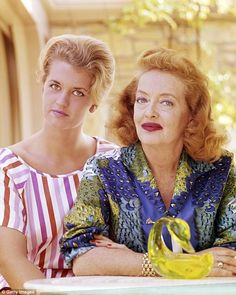 A neurotic, controlling and manipulative drunk who indulged in the occult and spent decades trying to break up her daughter's marriage – that's the shocking portrayal of legendary film star Bette Davis by her eldest child B.D. Hyman (pictured together in 1965)
